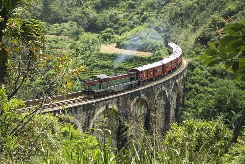 Steam train in the jungle, Ella, Sri Lanka. Full train on a nine arch bridge in the mountains of Ella, Sri Lanka royalty free stock photography