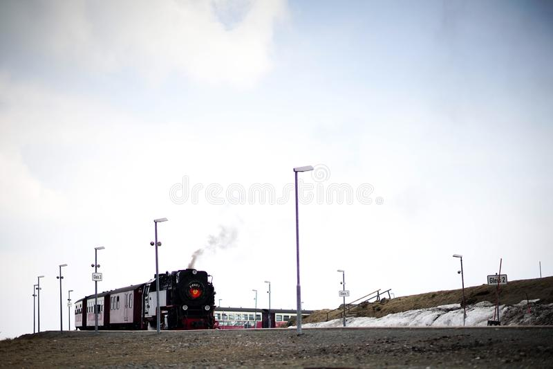 Steam train on the mountain. Steam train and the track on the Brocken top of the Harzberg mountain。The Brocken, also sometimes referred to as the stock images