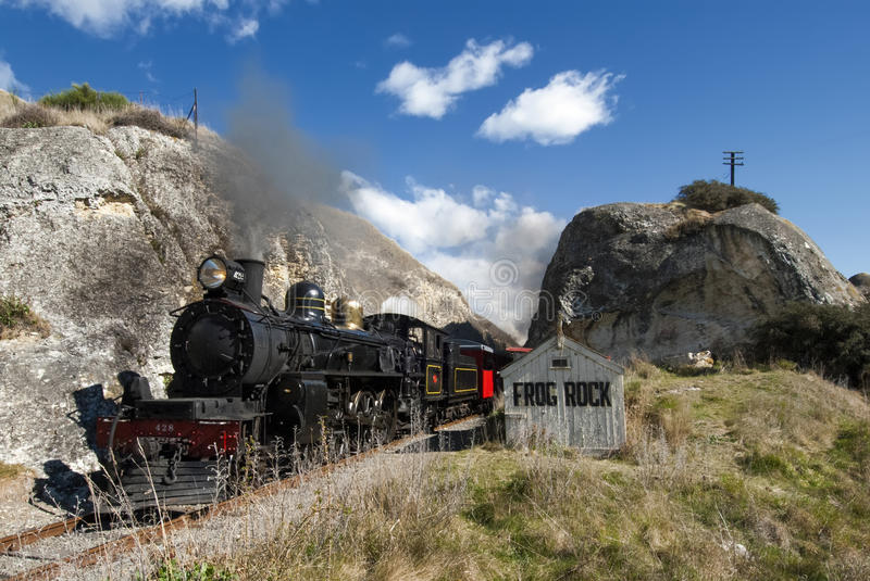 Steam train passing Frog Rock, Canterbury, New Zealand stock photo