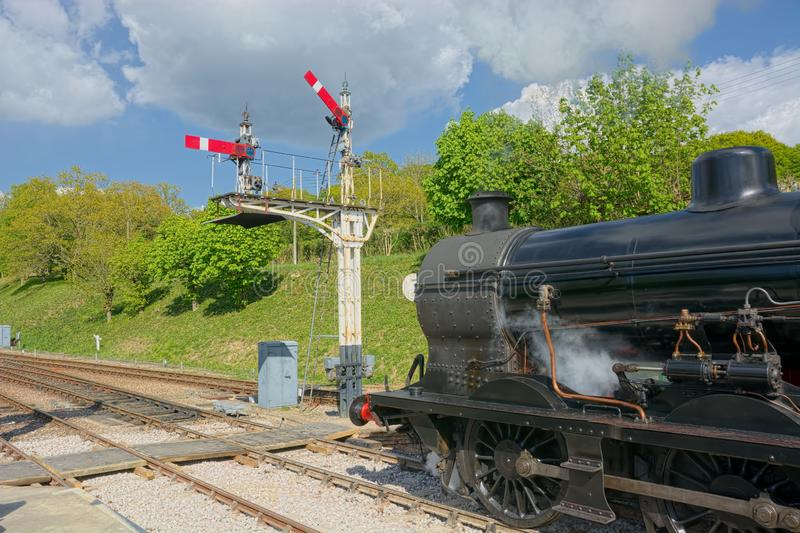 Steam train and signals royalty free stock photography