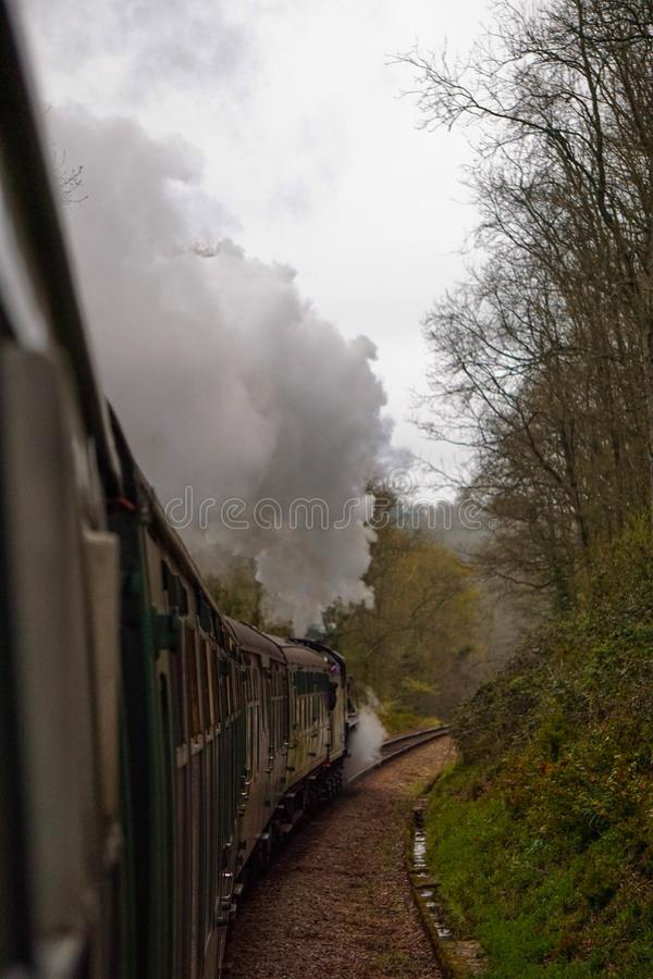 A steam train with smoke coming out royalty free stock photos