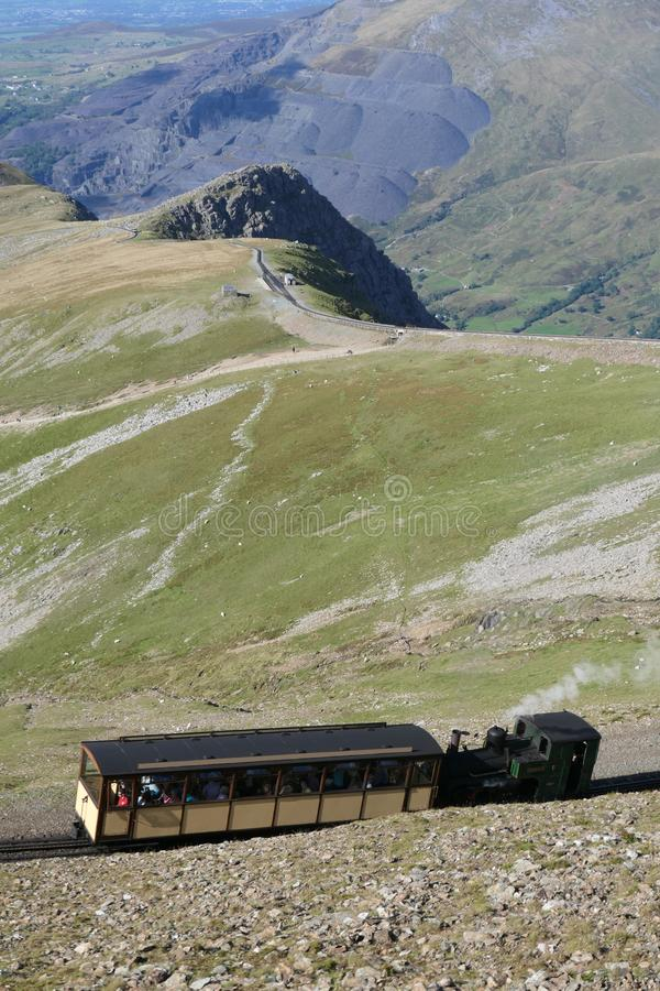 A steam train of the Snowdon Mountain Railway ascending to the summit of Mount Snowdon stock image