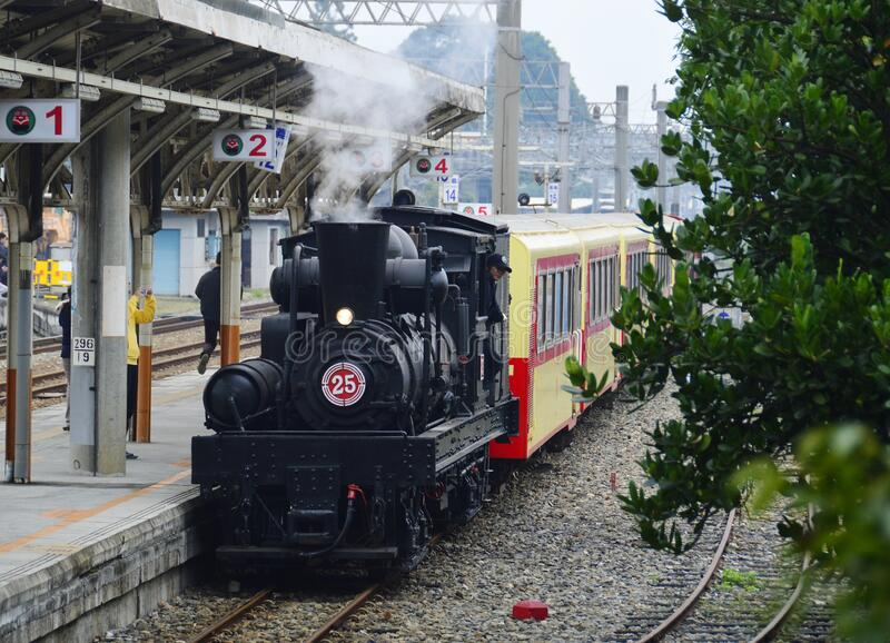 A steam train stops at  chiayi railway station. A steam train stops at chiayi railway station,Taiwan royalty free stock images