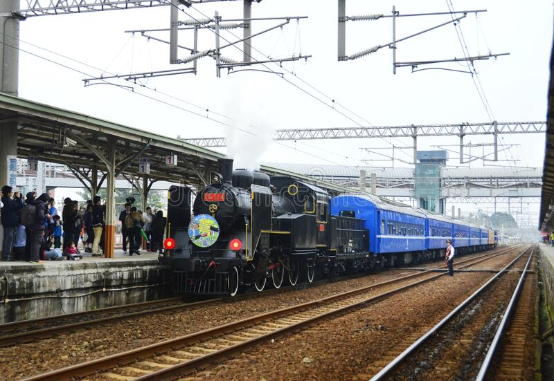 A steam train stops at Chiayi railway station. Taiwan stock photos