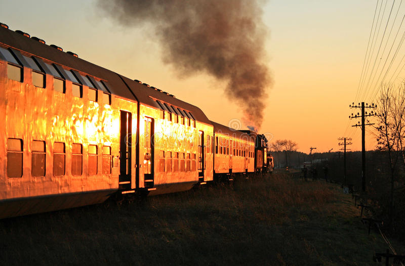 Steam train during sunset royalty free stock photo