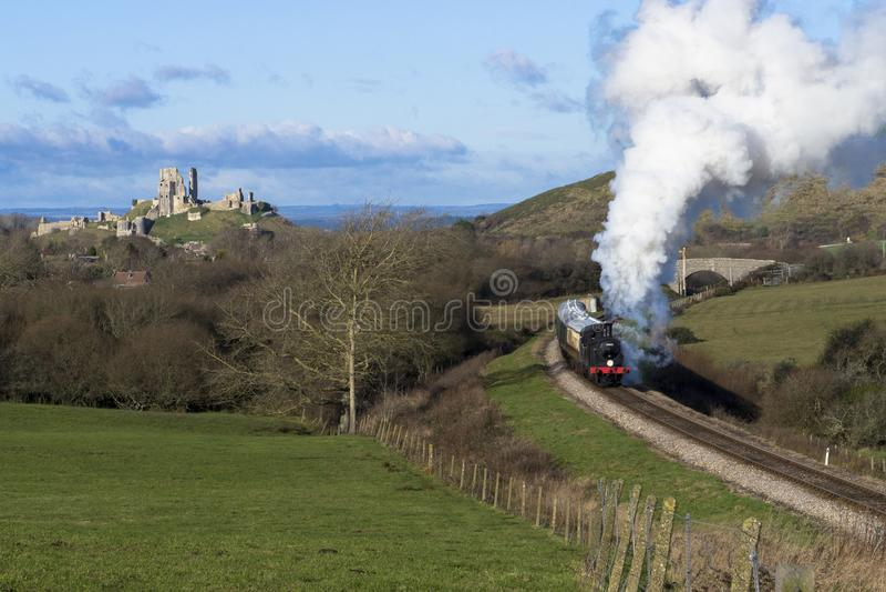 Steam Train on the Swanage Railway near Corfe Castle, Dorset.England. A class M7 tank locomotive number 30053 heads the 12.15pm steam train from Corfe Castle to royalty free stock photos