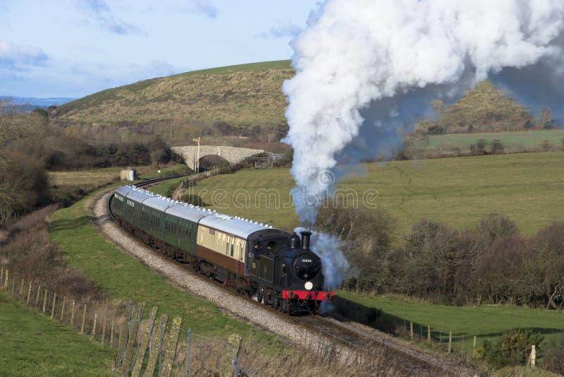 Steam Train on the Swanage Railway near Corfe Castle, Dorset.England. A class M7 tank locomotive number 30053 heads the 12.15pm steam train from Corfe Castle to stock image
