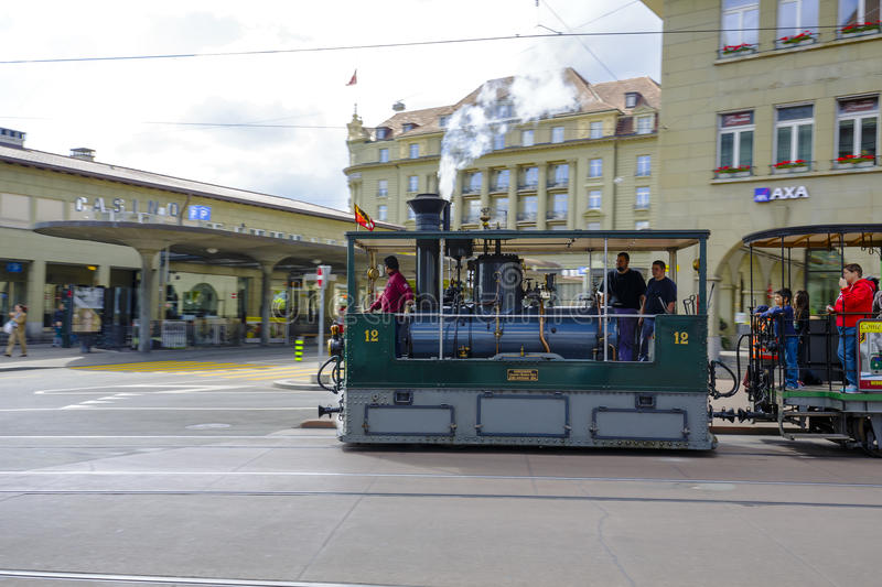 The steam tram rides on city rails in Bern stock image