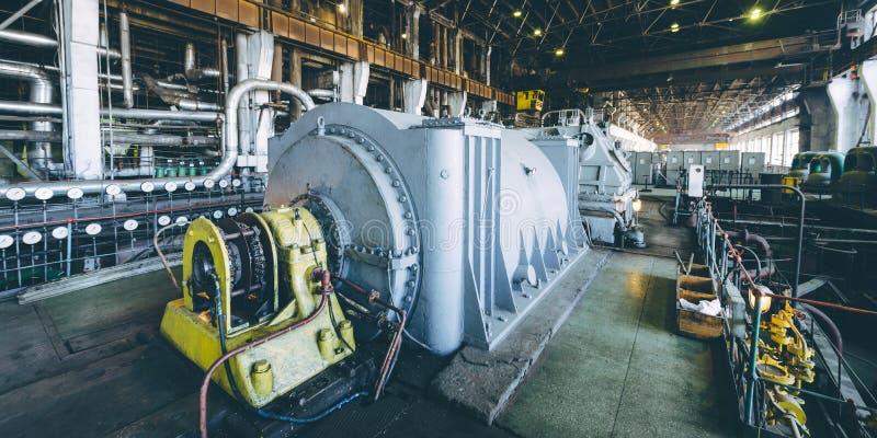 Steam turbine at power plant. Factory energy heat royalty free stock photos