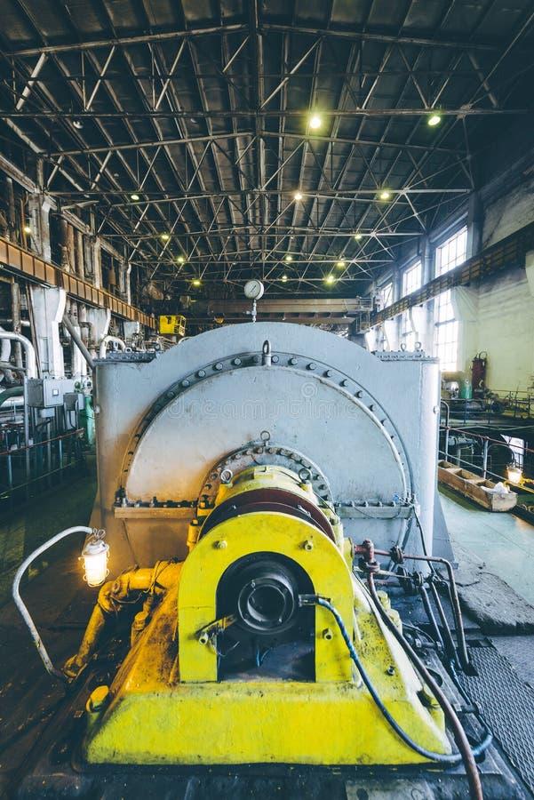 Steam turbine at power plant. Factory energy heat royalty free stock photo