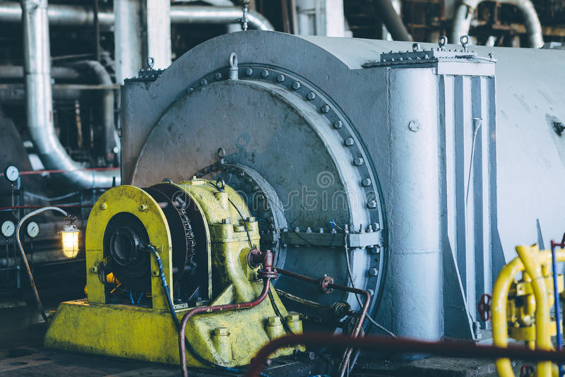 Steam turbine at power plant. Factory energy heat stock images