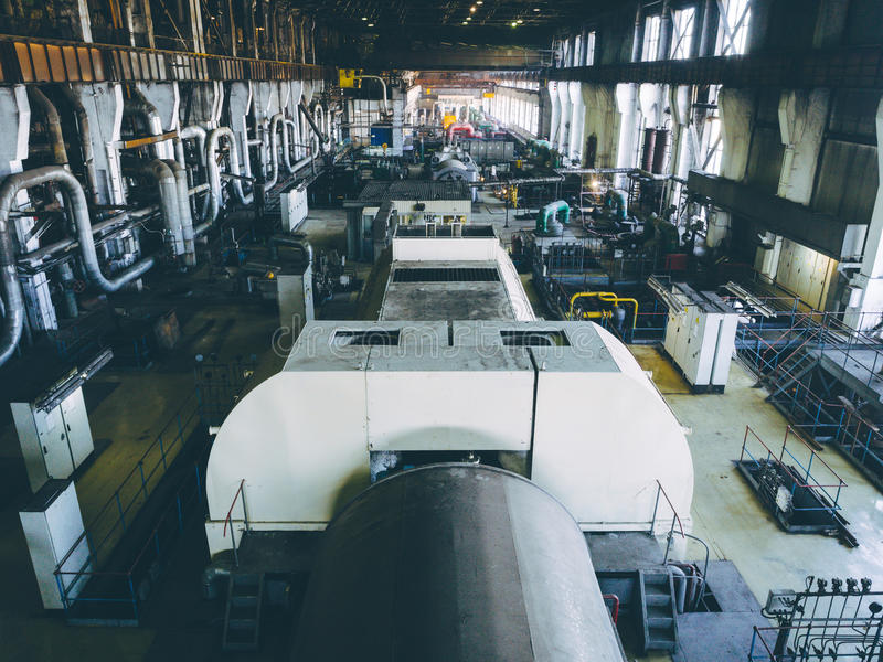 Steam turbine at power plant. Factory energy heat royalty free stock photography