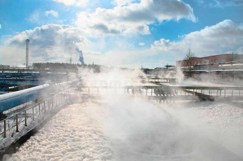 Steam on water recycling station royalty free stock photography