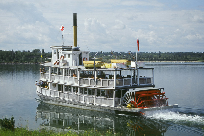 Steamboat. Old fashioned steamboat makes it's way from shore in Calgary, Alberta, Canada