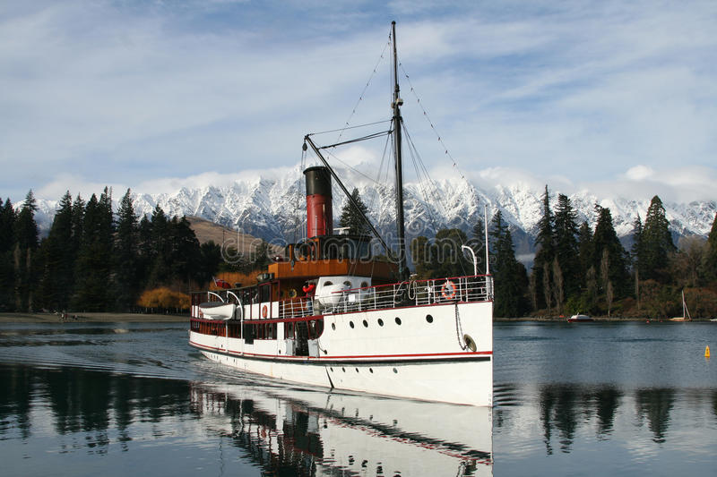 Steamboat on lake stock photography