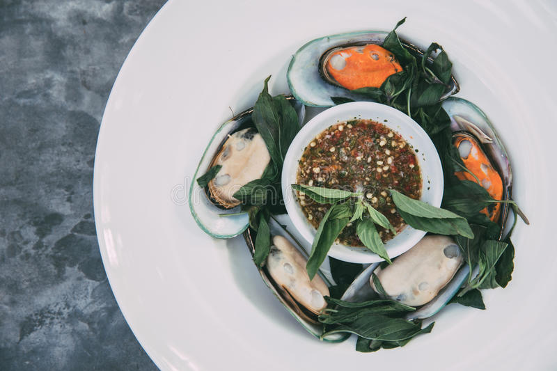 Steamed Asian green mussel with basil stock photo