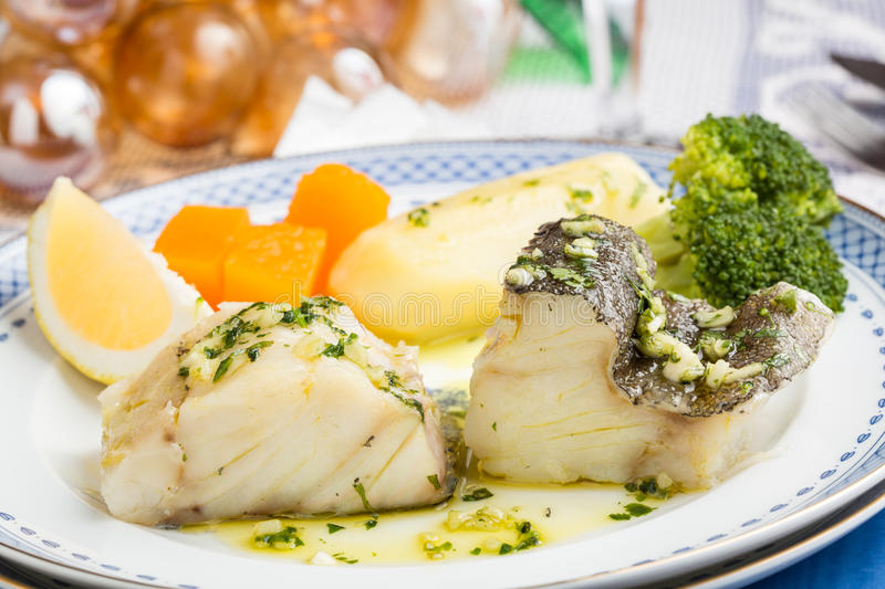 Steamed Atlantic Cod fish with olive oil and garlic royalty free stock photos