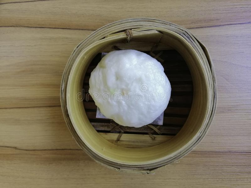 Steamed buns in wood basket stock photos