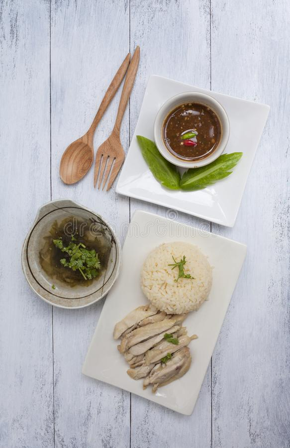 Steamed chicken with rice serve with seaweed soup and spicy sauce royalty free stock images