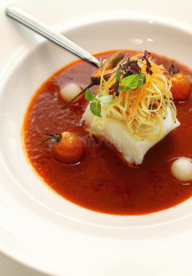 Steamed cod fish in hot and sour gravy royalty free stock photo