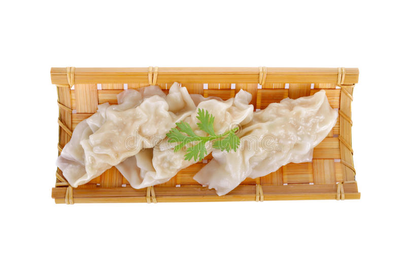 Steamed crab dumpling on bamboo plate on white background stock photography