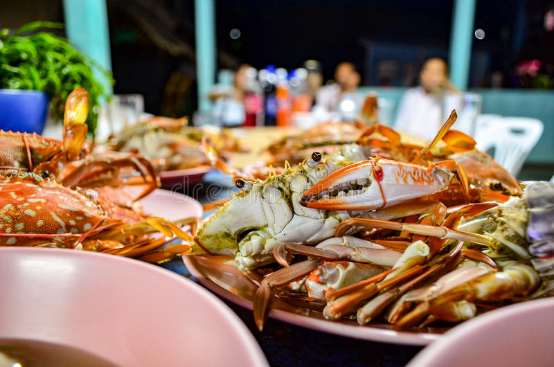 Steamed crab feast. Steamed crabs, orange palatable party in the country stock image