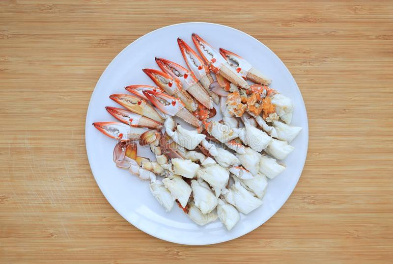 Steamed crab meat in white circle plate on wooden board background. Ready to eat. Top view stock photos