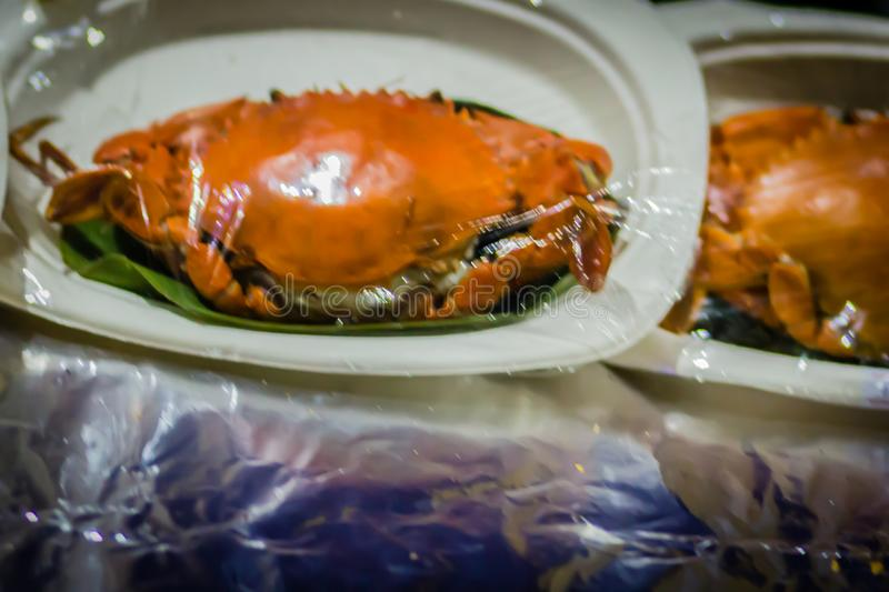 Steamed crab for sale at the seafood restaurant. Boiled crab for sale that wrapped with plastic and ready to bring back home. royalty free stock photos