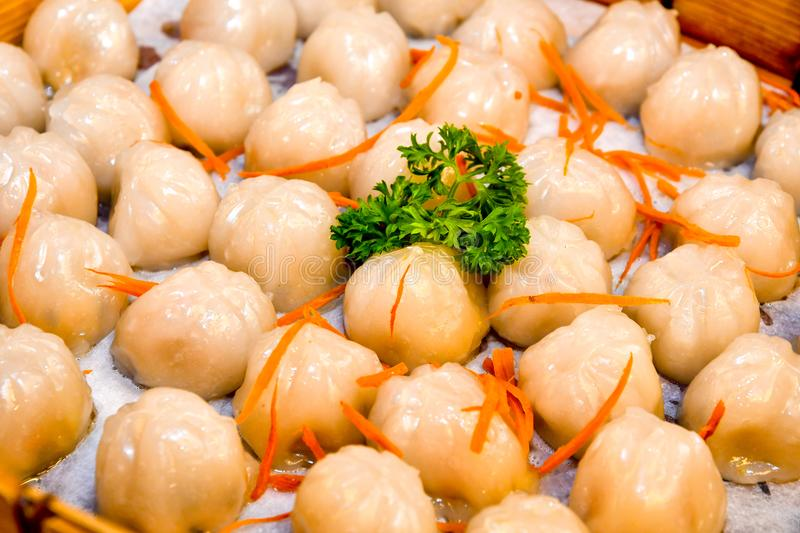 Steamed Crystal Skin Dumplings. Classic steamed dumplings were then served in traditional bamboo steamers, starting with the Steamed Crystal Skin Shrimp stock photo