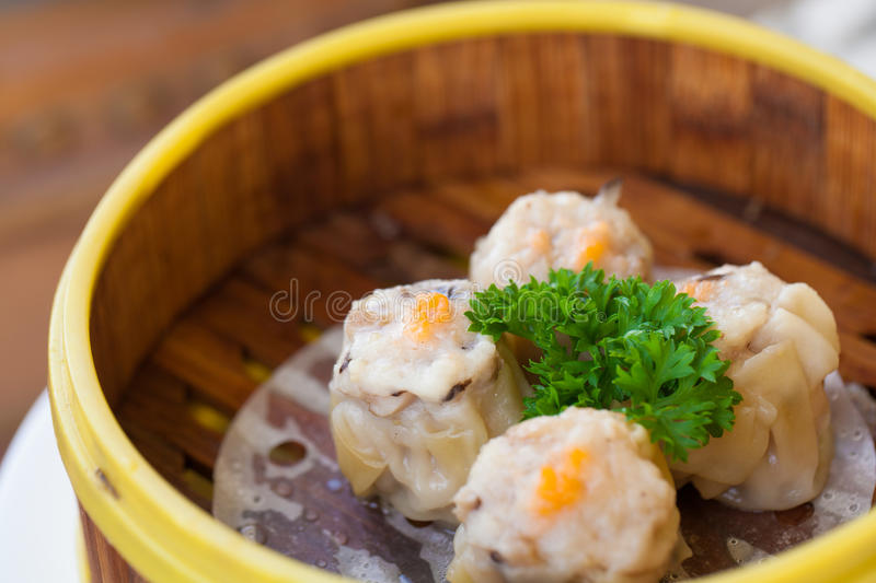 Steamed dumpling. Chinese steamed dumpling or Dim sum stuffed with minced pork decorated in bamboo made steamer local style royalty free stock images
