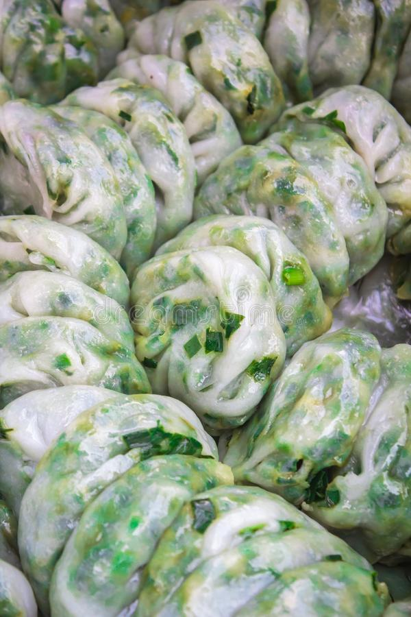 Steamed dumpling stuffed with garlic chives, Kanom Kuicheai stock photo