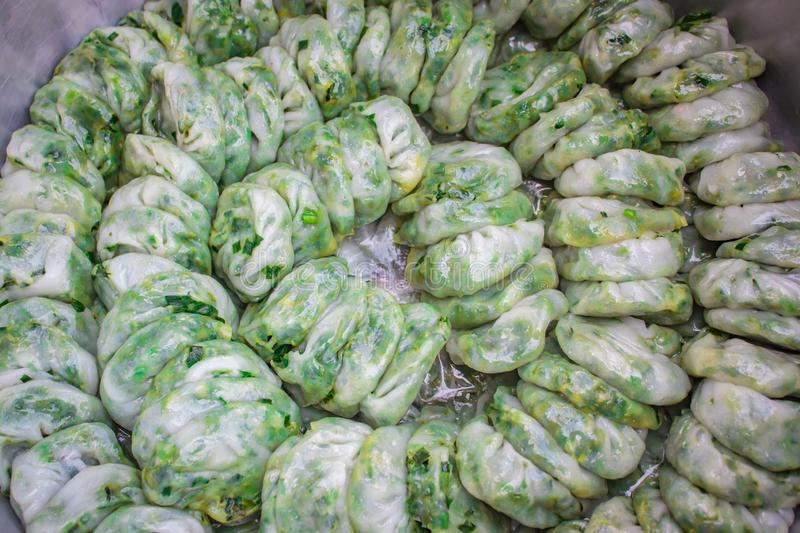 Steamed dumpling stuffed with garlic chives, Kanom Kuicheai stock images