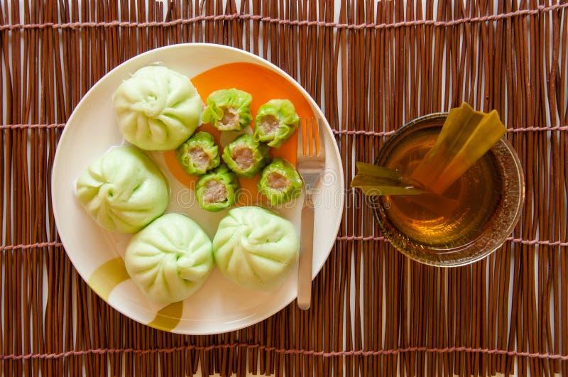 Steamed dumplings wih cup of tea royalty free stock images