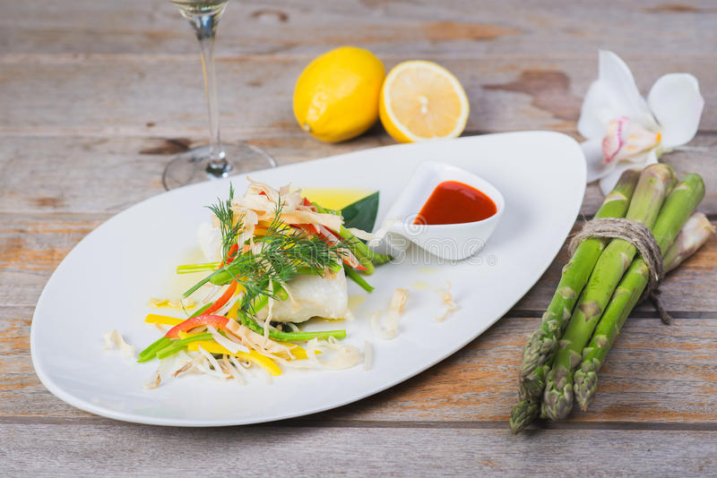 Steamed fillet of sea bass stock image