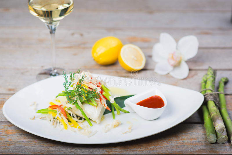 Steamed fillet of sea bass stock images
