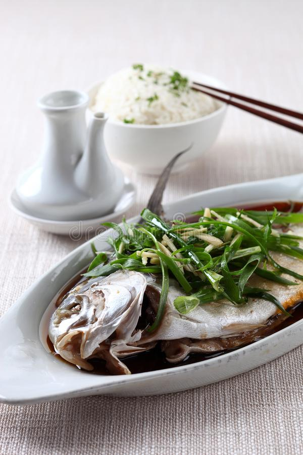 Steamed fish with soy sauce. On linen stock photos