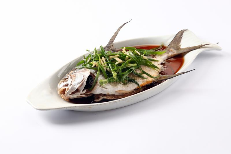 Steamed fish with soy sauce. On white background stock image