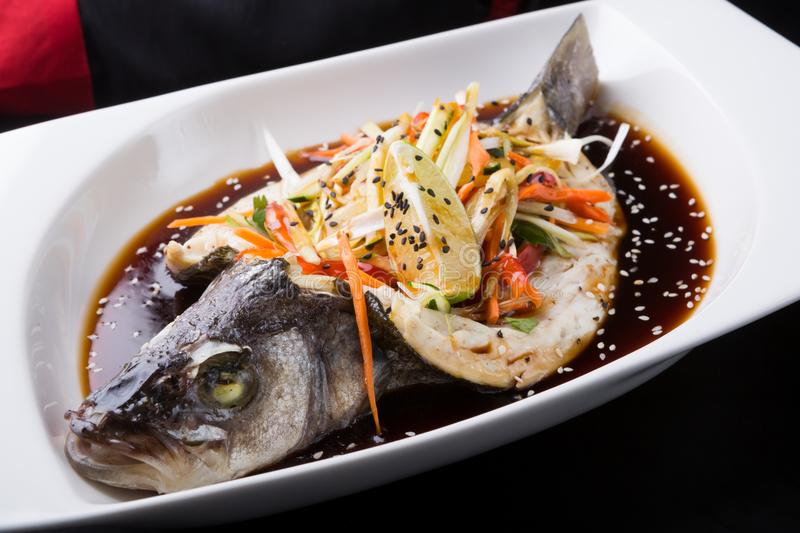 Steamed fish with soy sauce stock photos
