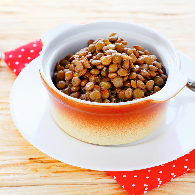 Steamed green lentils in pot royalty free stock photography