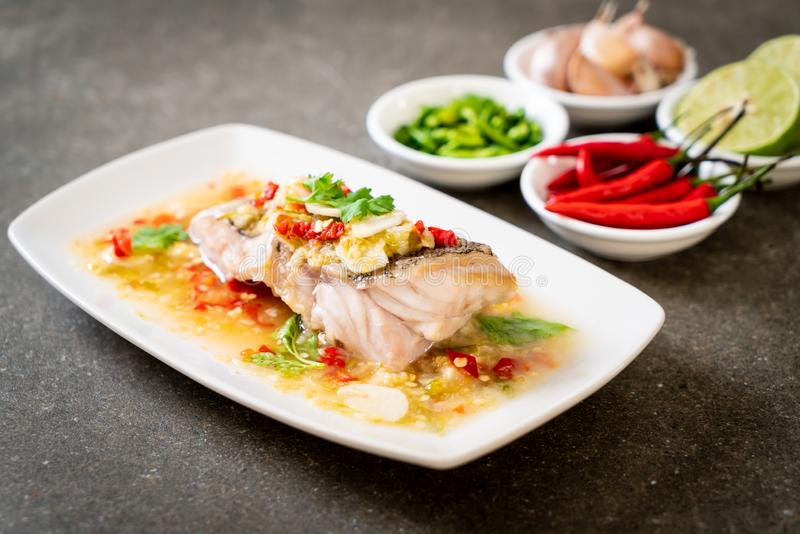 Steamed Grouper Fish Fillet with Chili Lime Sauce in lime dressing. Asian food style royalty free stock photos
