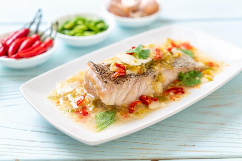Steamed Grouper Fish Fillet with Chili Lime Sauce in lime dressing. Asian food style royalty free stock images