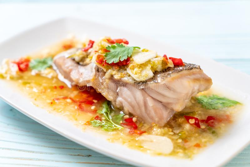 Steamed Grouper Fish Fillet with Chili Lime Sauce in lime dressing. Asian food style royalty free stock image