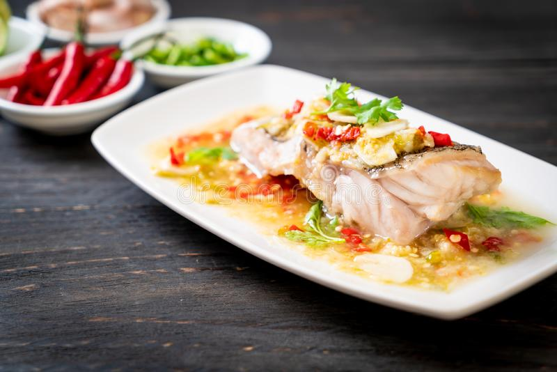 Steamed Grouper Fish Fillet with Chili Lime Sauce in lime dressing stock image