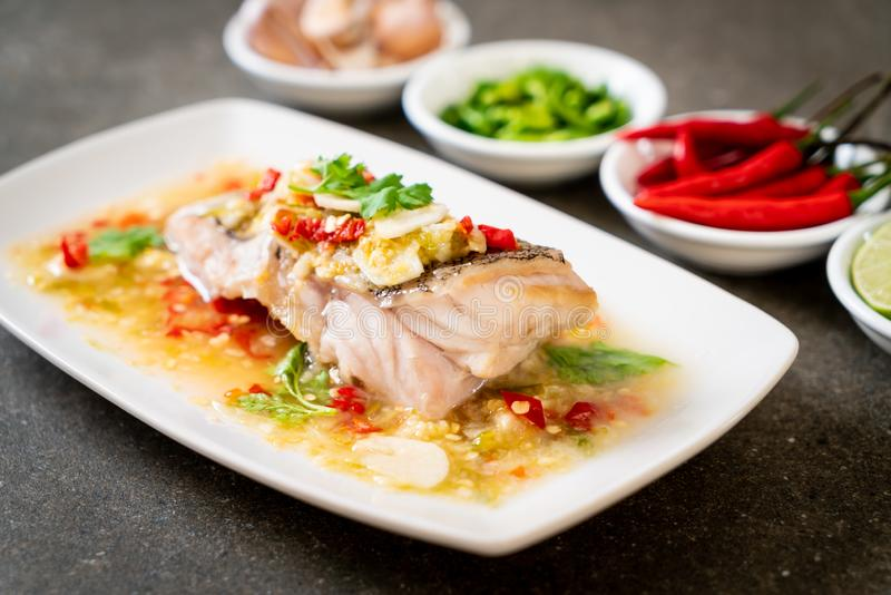 Steamed Grouper Fish Fillet with Chili Lime Sauce in lime dressing royalty free stock image