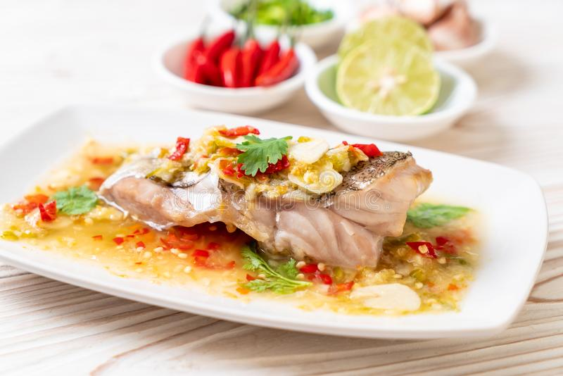 Steamed Grouper Fish Fillet with Chili Lime Sauce in lime dressing stock photos