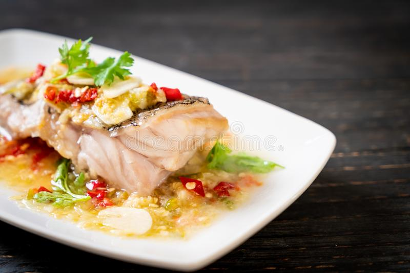 Steamed Grouper Fish Fillet with Chili Lime Sauce in lime dressing. Asian food style stock photography