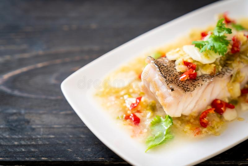 Steamed Grouper Fish Fillet with Chili Lime Sauce in lime dressing stock images