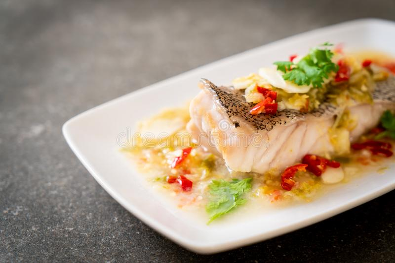 Steamed Grouper Fish Fillet with Chili Lime Sauce in lime dressing royalty free stock photography