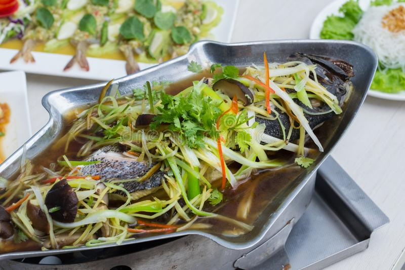 Steamed grouper with soy sauce stock image
