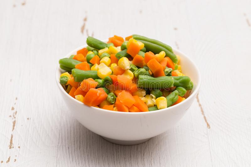 Steamed Mixed Vegetables. Isolated on a White Wood Table stock images